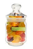 Candies in jar with a green note Stock Photo
