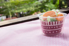 Candies. jelly candies in cup on a background. Stock Images