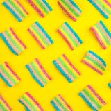 Candies with jelly and sugar pattern. Colorful array of different childs sweets and treats. Bright party background.  Royalty Free Stock Photography