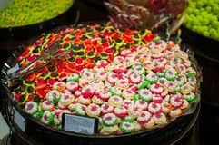 Candies and jellys in barrels Stock Images