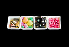 Candies in little plates Royalty Free Stock Photos
