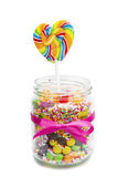 Candies and lollipop in jar Royalty Free Stock Image