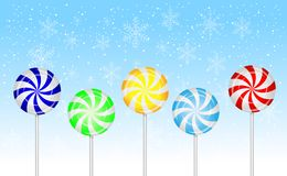 Candies lollipops on a blue background Royalty Free Stock Images