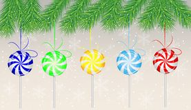 Candies lollipops hang on the branches of christmas tree Stock Photography