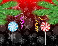 Candies lollipops hang on the branches of christmas tree Royalty Free Stock Photography