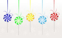 Candies lollipops hang on a white background Stock Image