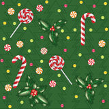 Candies, lollipops and holly berry Royalty Free Stock Photos