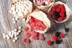 Candies. Many assorted sweet sugar candies on vintage wooden background Stock Photo