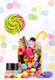 Candies and nail polish Stock Photography