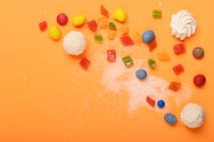 Candies on orange background Royalty Free Stock Photography