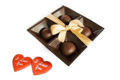Candies in the package with ribbon and two hearts Royalty Free Stock Photography