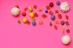 Candies on pink background Stock Photography