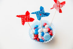 Candies with pinwheel toys on independence day Royalty Free Stock Photography