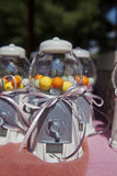 Candies into plastics candy jars Stock Photo