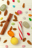 Candies, raisins and cinnamon at pages of notebook. Stock Image
