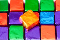 Candies in shiny wrappers background Stock Photography