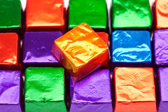 Candies in shiny wrappers background Stock Images