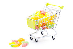 Candies in shopping cart Stock Images