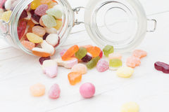 Candies spilled from a jar Stock Photos