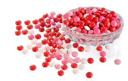 Candies spilling out of dish Royalty Free Stock Photography
