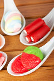 Candies in the spoons Stock Image
