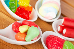 Candies in the spoons Stock Photo
