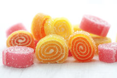 Candies. Sweet sugar candies on white wooden background Stock Image