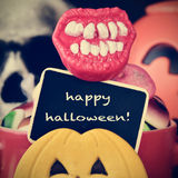 Candies and text happy halloween in a chalkboard, filtered Stock Photo