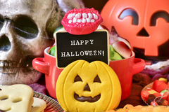 Candies and text happy halloween in a chalkboard royalty free stock photography