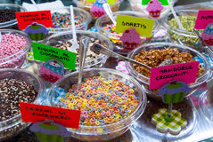 Candies. Variety of sweets and candies at display in italian cafeteria stock images