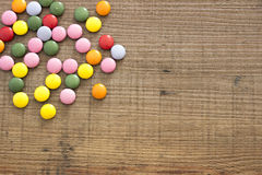 Candies on the wooden background Royalty Free Stock Images