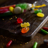 Candies on a wooden chopping board Stock Photo