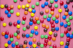 Candies on a wooden pink table Royalty Free Stock Image