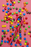Candies on a wooden pink table Royalty Free Stock Images