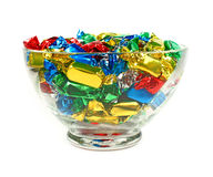 Candies. Wrapped in colored foil on white background stock image