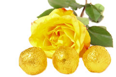 Candies and yellow rose Stock Images