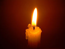 Candle. With tall erect flame Stock Image