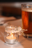 Candle. In glass at the wedding party Royalty Free Stock Photos