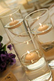 Candle. Inside a glass with flowers royalty free stock photography