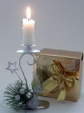 Candle. Christmas composition with a candle and a present Stock Photo