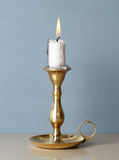 Candle. Antique metal candlestick with burning candle stock image