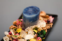 Blue Candle and Potpourri Royalty Free Stock Images