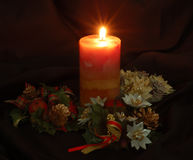 Candle. Light of candle and christmas decorations Stock Image