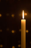 Candle. White christmas candle on dark black background Stock Image