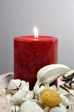 Candle. Burning candle with gray background Royalty Free Stock Photo