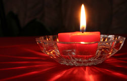 Candle. In glass holder, with reflecting light Royalty Free Stock Photos