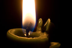 Candle. Single table candle in the dark Royalty Free Stock Photo
