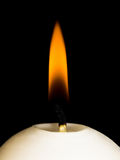 Candle. Fire  of waxen candle on a black background Stock Photo