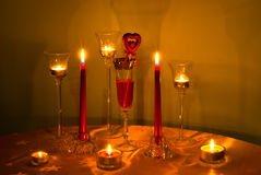 Candle. A candles and glass of wine Royalty Free Stock Image