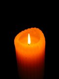 Candle. Burning Yellow Orange Scented Candle Stock Photography